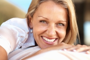 9-20-12-Closeup-of-a-beautiful-happy-mature-woman-smiling.jpg